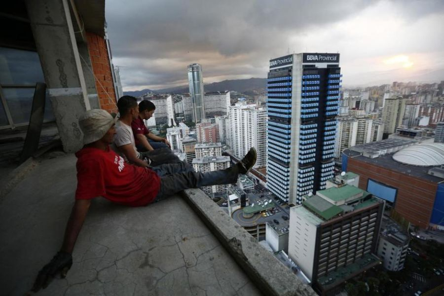 men-rest-after-salvaging-metal-on-the-30th-floor-of-the-tower-of-david-skyscraper-in-caracas