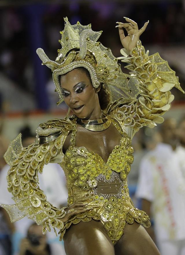 Drum queen Luana Bandeira, from Estacio de Sa samba school, dances during the Carnival parade at the Sambadrome in Rio de Janeiro, Brazil, Sunday, Feb. 7, 2016.